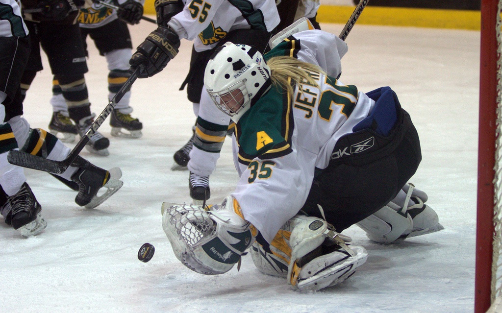 Women's university hockey action.